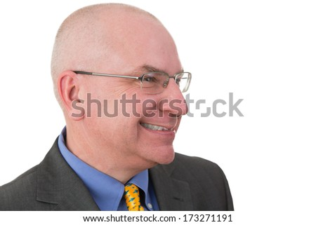 Middle-aged businessman giving a wry smile as he realizes the irony of a situation, head and shoulders portrait on white with his head turned to the side - stock photo