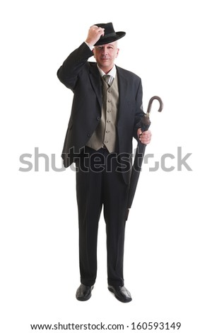 Middle aged  businessman in a retro business suit with umbrella isolated on white. - stock photo