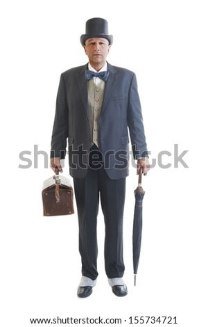 Middle aged  businessman in a retro business suit with valise and umbrella isolated on white. - stock photo
