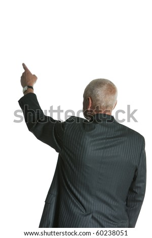 Middle Aged Businessman in Suit, Pointing viewed from behind isolated on white