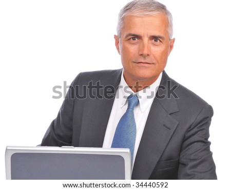 Middle Aged  Businessman seated looking over top of laptop isolated on white