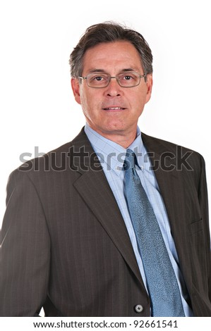 Middle aged businessman wearing eyeglasses, suit, and tie, looking at camera. - stock photo