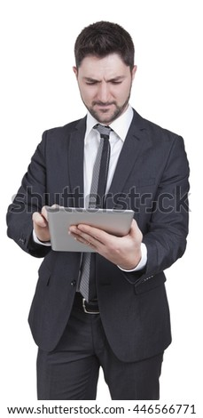middle-aged businessman with blue suit holding tablet