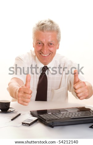 middle-aged businessman with laptop on white