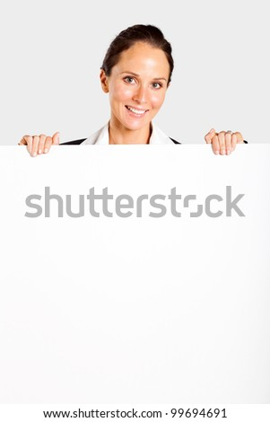 middle aged businesswoman behind white board - stock photo