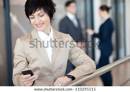 middle aged businesswoman using smart phone - stock photo