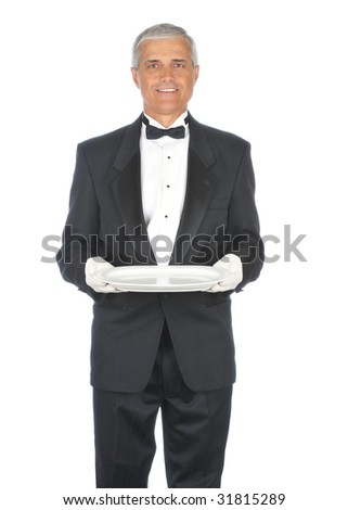 Middle Aged Butler Wearing a Tuxedo and holding an empty platter isolated on white - stock photo