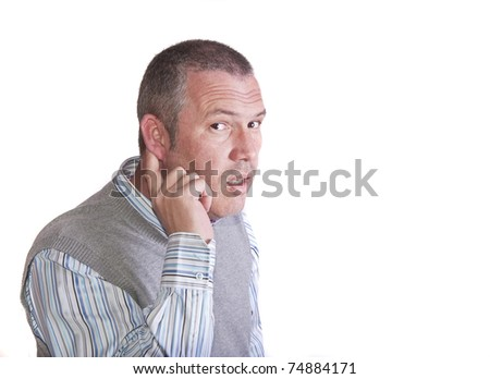 Middle aged caucasian male holds his ear to listen better to what you are saying