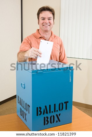 Middle aged caucasian man casting his ballot in the election. - stock photo