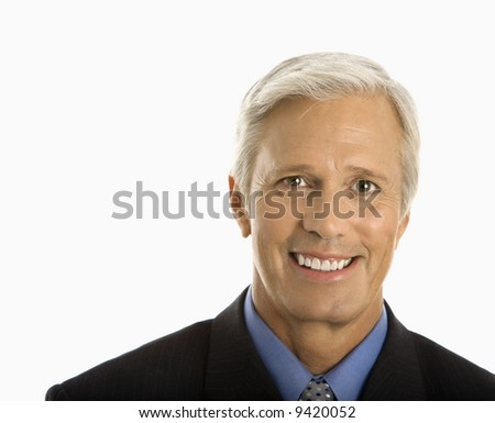 Middle aged Caucasian man in business suit smiling at viewer.