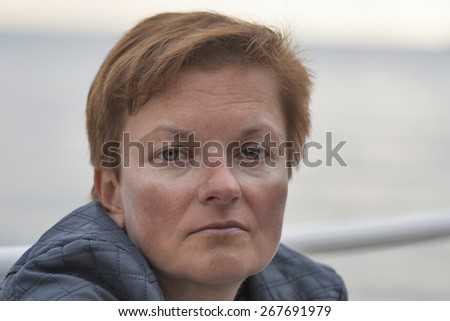 middle aged caucasian tanned woman outdoor portrait - stock photo