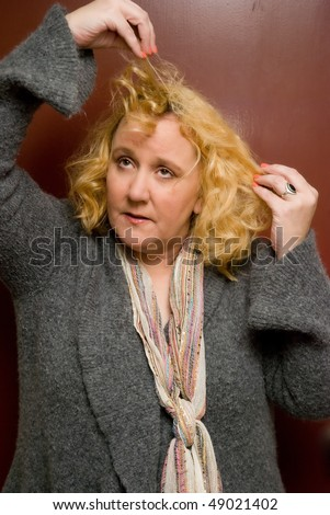 Middle aged caucasian woman having a bad hair day - stock photo