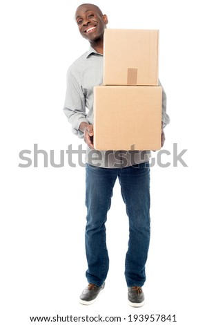 Middle aged corporate man holding stack of boxes - stock photo