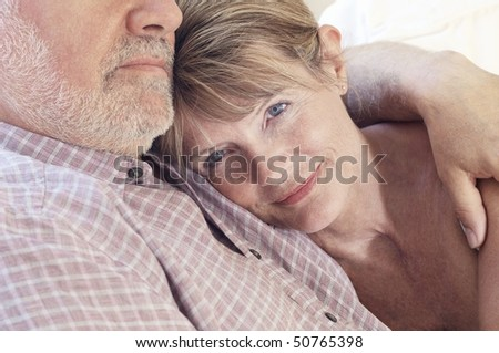 Middle aged couple, close up of woman - stock photo