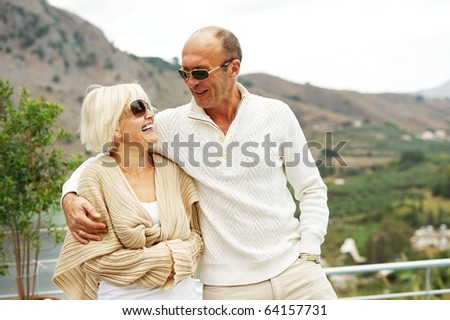 Middle-aged couple outdoors - stock photo