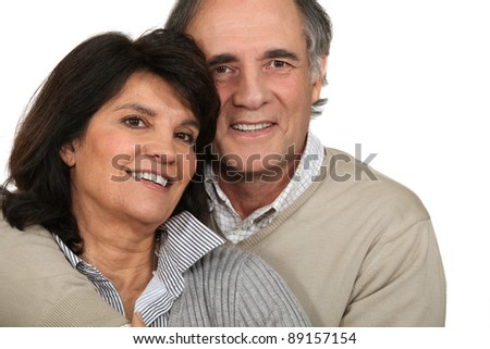 Middle-aged couple stood together - stock photo