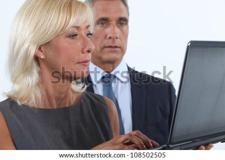 Middle-aged couple using laptop - stock photo
