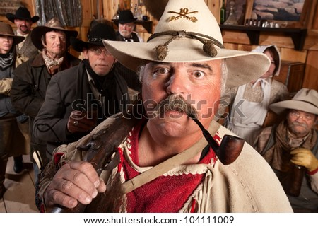 Middle aged cowboys in an old western saloon - stock photo