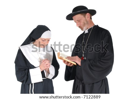 Middle aged devout nun and priest in deep thoughts, praying. Female hands crossed, male with bible in hand