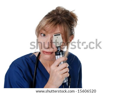 Middle aged doctor doing an eye exam - stock photo