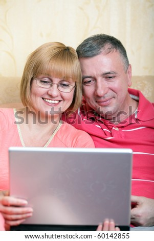 Middle-aged family enjoying their life surfing the internet - stock photo