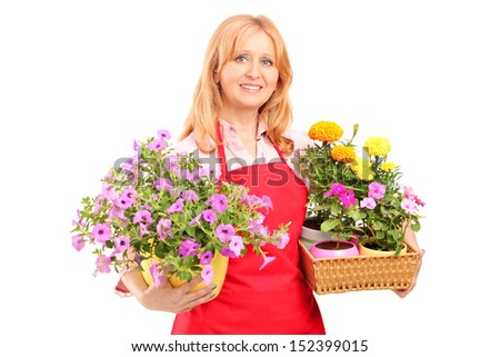 Middle aged female florist holding flowers isolated on white background - stock photo