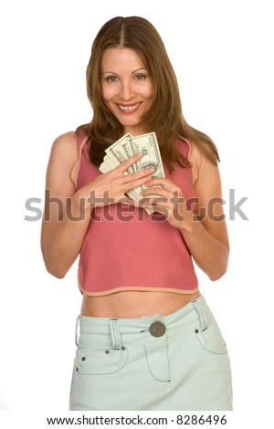 Middle-aged female holding pile of 100 dollar bills - stock photo