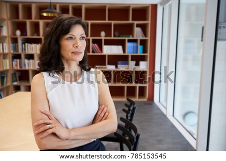 Middle aged female media creative in her office