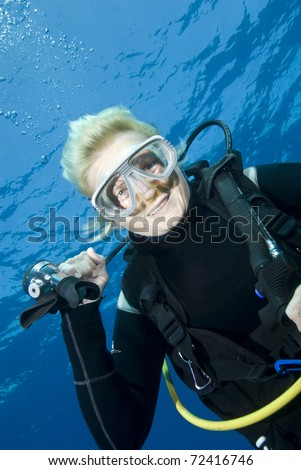 Middle-aged female scuba diver smiling into the lens. Tower, Sharm el Sheikh, Red Sea, Egypt. - stock photo