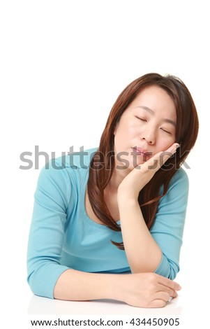 middle aged Japanese Woman Sleeping on the Table - stock photo