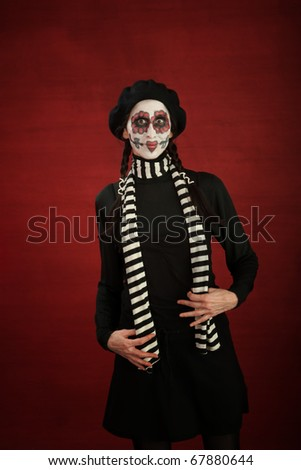 Middle-aged lady with freakish flowery make-up - stock photo