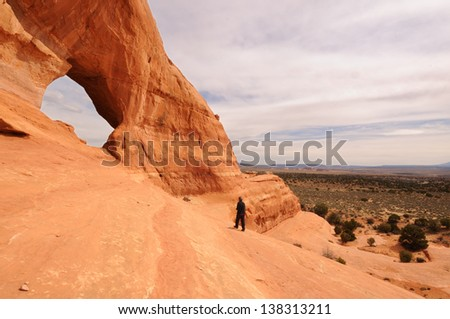 Middle-Aged Male Hiker By Looking Glass Arch Near Moab Utah - stock photo