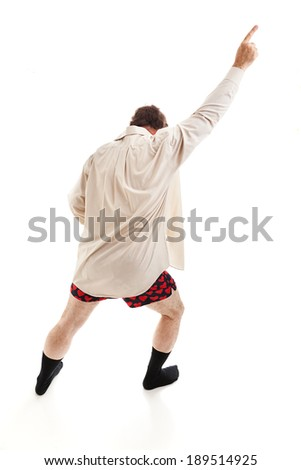 Middle aged man dancing around in his socks, shirt, and underwear, singing old time rock & roll songs.  Isolated on white.   - stock photo