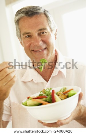 Middle Aged Man Eating A Healthy Salad - stock photo