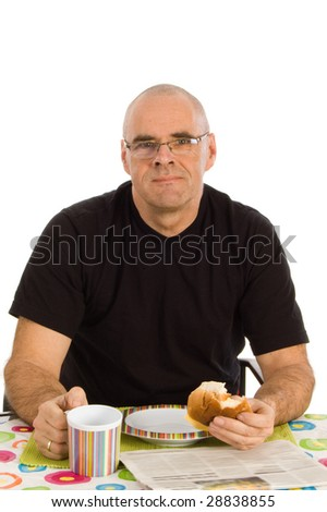 Middle-aged man eating breakfast on a table