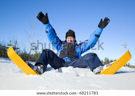Middle-aged man falling to snow - stock photo