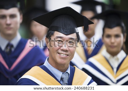 Middle-Aged Man Graduating from College - stock photo