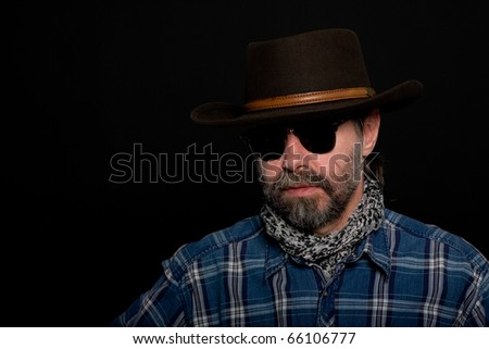 Middle aged man in a cowboy hat.