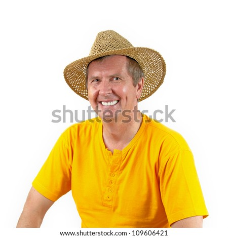 Middle aged man in a straw hat on a white background