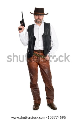 Middle aged man in leather pants with a gun. - stock photo