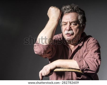 middle-aged man in plade shirt with mustashe  - stock photo