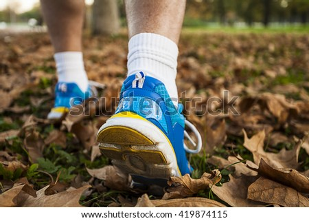 Middle-aged man in running shoes foliage walking foliage walking foliage walking foliage walking foliage walking foliage walking foliage walking foliage walking foliage walking foliage walking  - stock photo