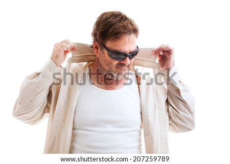 Middle aged man in sunglasses and shirt with turned up collar, trying to be cool.  Isolated on white.   - stock photo