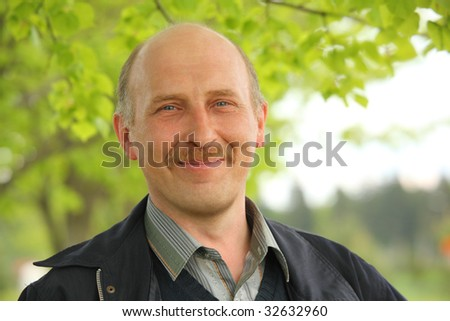 middle-aged man in the summer park - stock photo