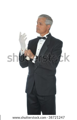 Middle Aged  Man in Tuxedo Putting on White Gloves isolated on white - stock photo