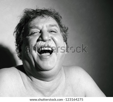middle-aged man laught - stock photo