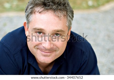 middle aged man looking at camera - stock photo