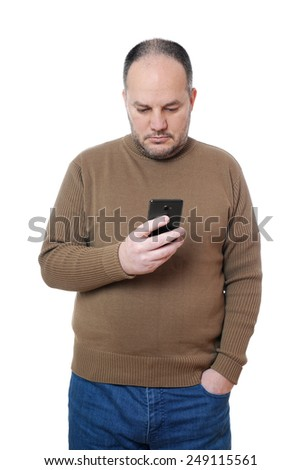 middle aged man looking down at his mobile cell smart phone