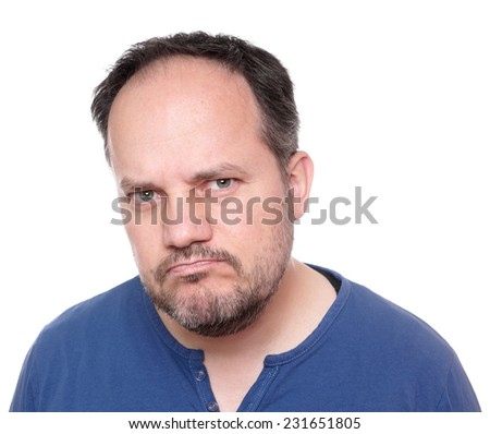 middle aged man looking skeptical and unhappy - stock photo