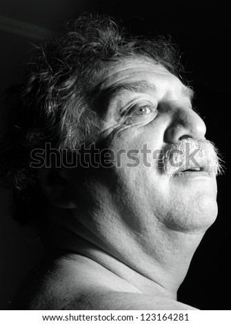 middle-aged man looks up - stock photo